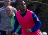 In training: QPR defender Ferdinand is put through his paces ahead of Saturday's clash with Chelsea
