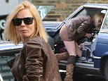 That's rather sexy for the school run: Geri Halliwell stands out from the other mums in a LBD (that's a little brown dress)