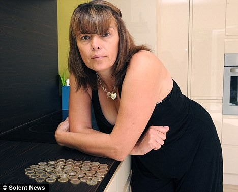 Frozen out: Ice cream lady Joanne Bath, was turned away at the checkout of her local Asda store when tried to pay for her £100 shop with fifty £2 coins
