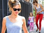 Red hot mum: Alessandra Ambrosio slips her pins into red skinny jeans to pick up daughter