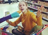 Teeny-tiny: Peaches Geldof tweeted a snap of herself sat in a supermarket trolley using a baguette as a microphone