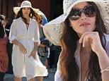 Simple style statement: Monica Bellucci wows in an all white outfit as she shoots scenes for a commercial