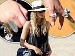 Delta Goodrem seen out shopping wearing lots of rings