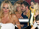 Blame it on Rio! Pamela Anderson breaks 'no men' vow as she cosies up to mystery man in Brazil