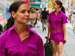Whoops! Katie Holmes narrowly avoids a wardrobe malfunction as she steps out in hot pink shirt dress