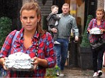 Nursing a hangover? Coleen Rooney carries trays of leftovers as she leaves lunch with Wayne and Kai the day after a big night out