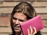 Pimple problems: 90210 vixen AnnaLynne McCord attempted to cover up her acne with a pocketbook while on the way out of a Los Angeles market yesterday