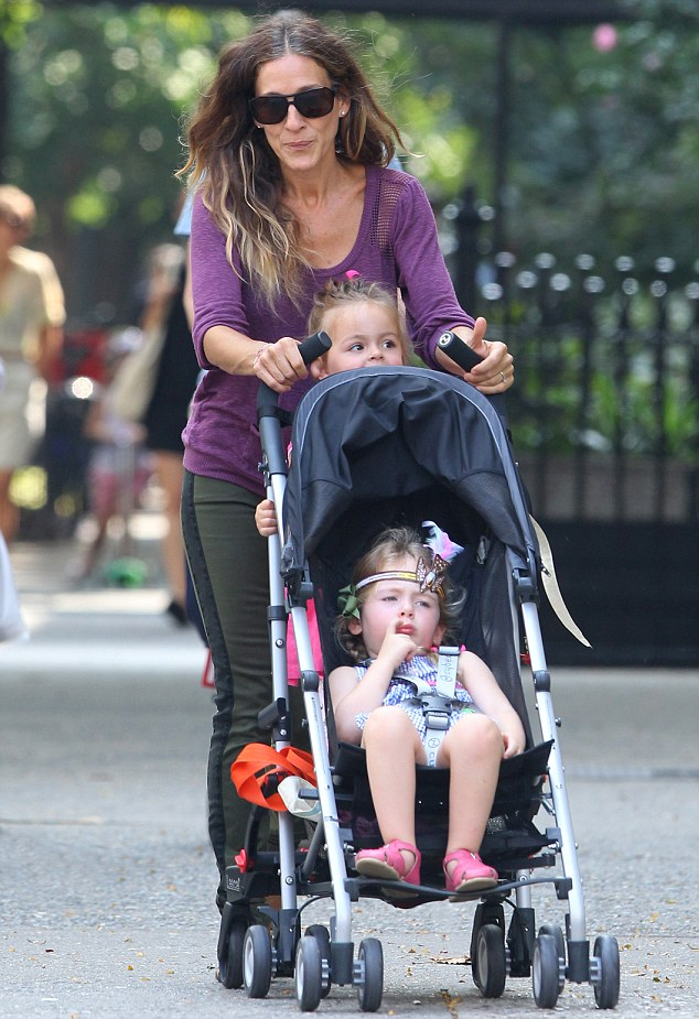 Juggling roles: Sarah Jessica Parker took her twin daughters Marion and Tabitha for a walk in Manhattan today