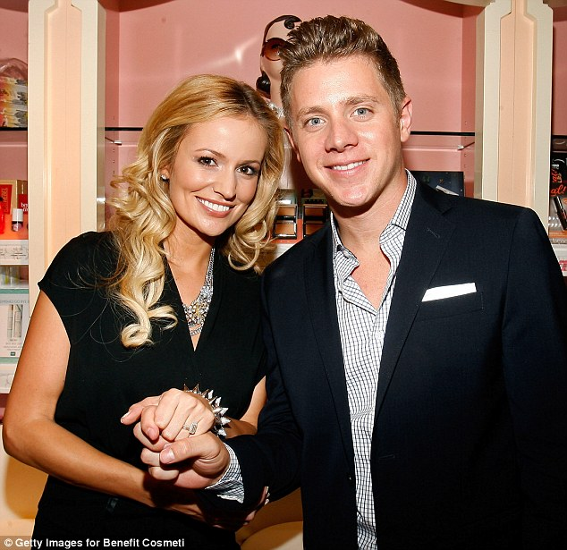 Going rock? Emily Maynard wore a bizarre studded bracelet as she attended with Jef Holm