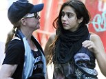 Madonna stepped out in New York City today with 15-year-old daughter Lourdes en route to the Kabbalah Centre