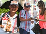 That's one happy fan! Alessandra Ambrosio signs a copy of GQ Brazil... which just happens to feature her bikini-clad self
