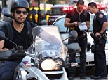 Try wriggling out of this one!: Magician David Blaine fails to elude the NYPD