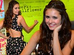 Subtly sexy: The 23-year-old star made sure cameras got a shot of the cut-out as she signed autographs in Atlanta on Saturday