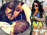 Snooki displays her very slim post pregnancy figure as she resumes filming just under THREE weeks after giving birth to baby boy Lorenzo