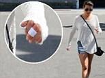 Tatt must be painful! Glee star Lea Michele gets her red heart tattoo removed from her left middle finger