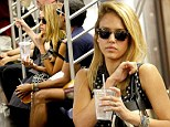Going underground: Jessica Alba gives New York commuters an eyeful as she rides the subway in a graphic ensemble