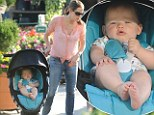 Baby bloomer! Jennifer Garner's son Samuel stays snuggled in his stroller as his mother and two sisters buys plants at the nursery