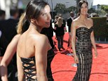Padma Lakshmi scores a rare fashion miss as tight dress struggles to contain her curves at the Creative Arts Emmys