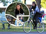 Pregnant supermodel Gisele Bundchen is a doting mother as she takes her boys bike riding in the park