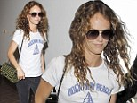 Au naturel! Vanessa Paradis is make-up free and low key as she flies out of LAX