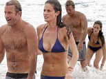 It's a hard life! Scott Caan frolics with bikini babe in the surf as he films Hawaii Five-O