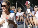 Julie Bowen is all smiles as she gets snow cones for her boys