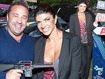 Is that a wise crack? Teresa Giudice's husband Joe laughs off rows with his Real Housewife by jokingly pointing a gun at her