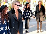 Gilding the Lily! Starlet Collins dons star spangled knitwear for Toronto outing with Jamie Campbell Bower