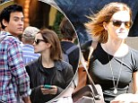 Still rocking the student look: Emma Watson dresses down for day out with boyfriend Will Adamowicz