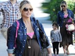 Blooming lovely! Heavily pregnant Sarah Michelle Gellar wears it well
