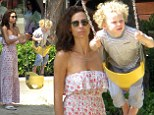 Minnie Driver pushing her son Henry on the swing set at Cross Creek park in Malibu, California