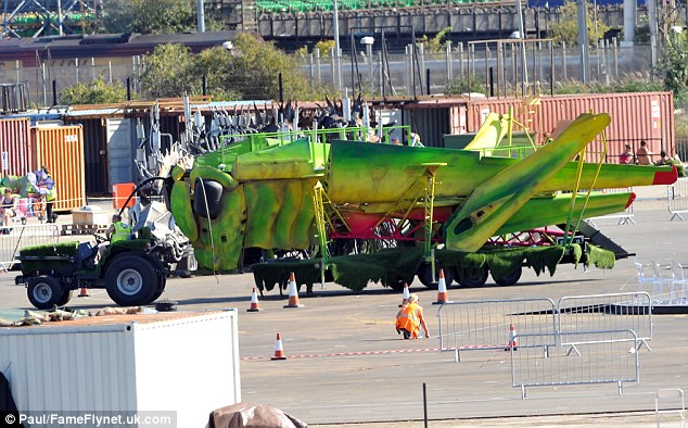 The big green machine: A large truck disguised as a grass hopper was seen driving past the main stage area