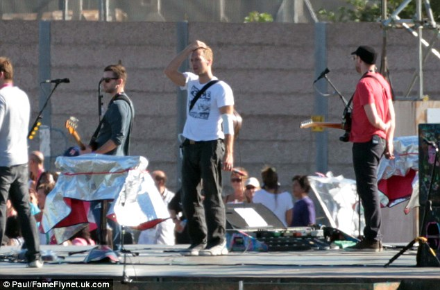 The legends: Coldplay were seen rehearsing in a big car park, earlier today, ahead of their Paralympic Closing Ceremony performance on Sunday