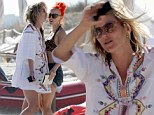 It's kaftan Kate! Ms Moss covers up her curvier bikini body as she continues making the most of Formentera holiday
