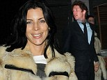 That smile says it all! Liberty Ross moves on from Rupert Sanders' affair as she leaves club hand-in-hand with mystery man