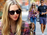 Amanda Seyfried dotes on her dog as she takes him and a male friend for a stroll in New York