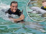 Having a whale of a time! One Direction's Louis Tomlinson and Liam Payne swim with dolphins on holiday in Florida