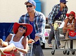 A trolley full of fun! Carefree Kellan Lutz gives girlfriend Sharni Vinson a playful ride in a shopping cart