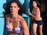 On the run: Daniela Ruah darts out of a bar in a bikini top and shorts to chase after a criminal while filming scenes for NCIS: Los Angeles on Tuesday