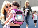 Hands on: Heavily pregnant Sarah Michelle Gellar carried her daughter on the school run on Tuesday