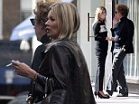 Ditching the health kick: Kate Moss spotted puffing a cigarette during London shopping trip