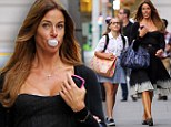 Grow up Mom! Kelly Bensimon blows bubbles as her daughter Thaddeus looks on in disapproval