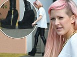 Ellie Goulding looks slightly worried as she tries to walk in high boots that resemble clogs