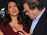 Touchy-feely: Oliver Stone seemed utterly enamoured by actress Salma Hayek as they attended a photocall for Savages on Wednesday afternoon