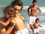 Life's a beach! Kourtney Kardashian's young son Mason has a ball with father Scott Disick as they settle into Miami life