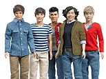 Plastic fantastic: These One Direction fashion dolls will be on many childrens' wishlists for Christmas this year according to Toys R Us