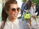 The perils of heels and cobbles! Kourtney Kardashian struggles in her stilettos on Miami shopping trip with Khloe