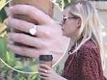 Kirsten Dunst steps out sporting a rather large diamond ring on her finger