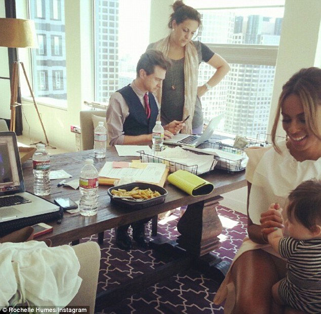 'Watching Uncle Marv': Rochelle plays with Una's baby Aoife as they watch JLS in concert on a laptop