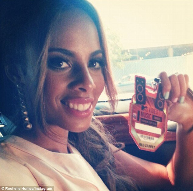 She's got the golden ticket: Rochelle shows off her red carpet pass for the VMAs